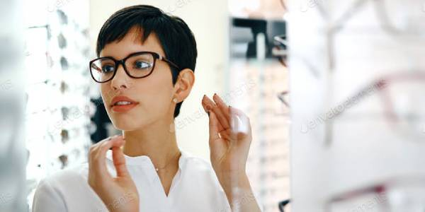 A Woman Selecting Eyeglasses.