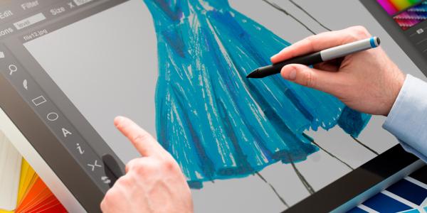 An Image Showing Fshion Designer Designing Fashion Tablet On His Tablet.